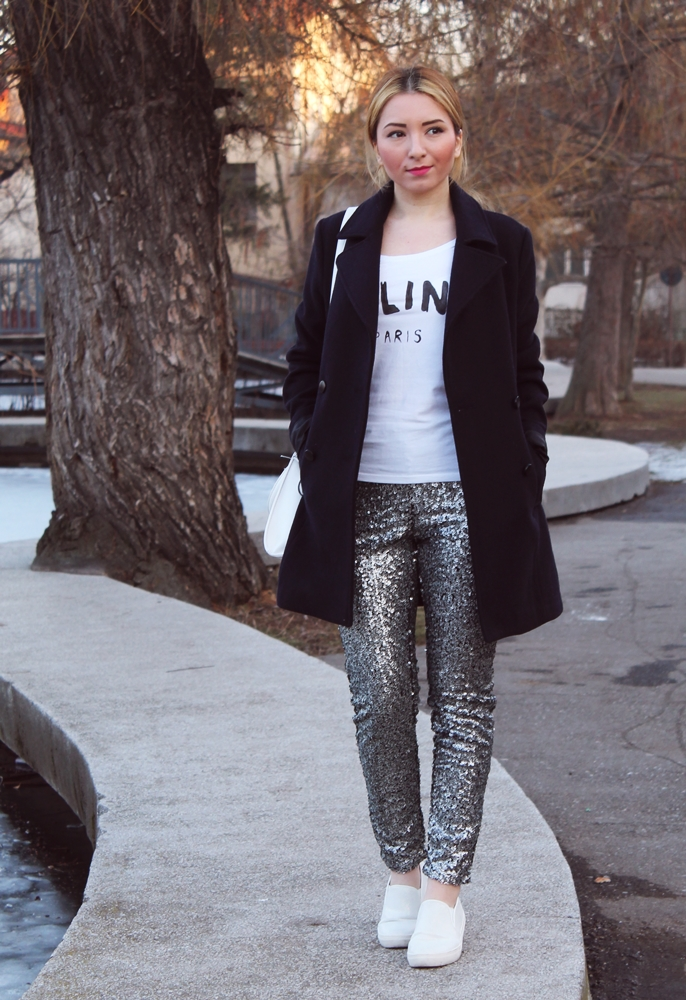 Street style sequin pants, black coat, celine tshirt, white sneakers