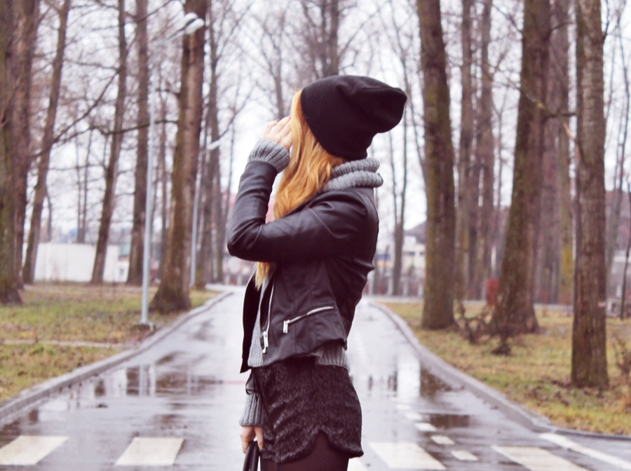 Street style short sequin pants and black leather jacket with beanie