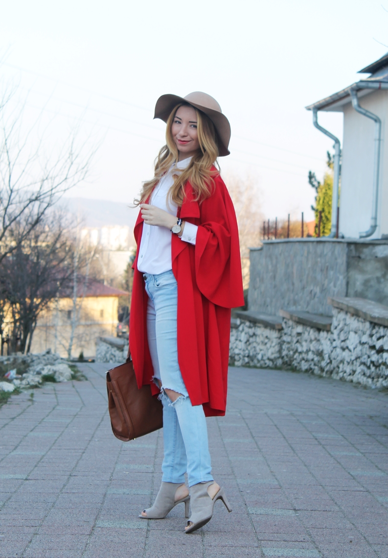 Andreea Pantilinescu, street style red long cape, ripped jeans, camel hat, camel sandals, brown bag, white shirt, daniel wellington watch