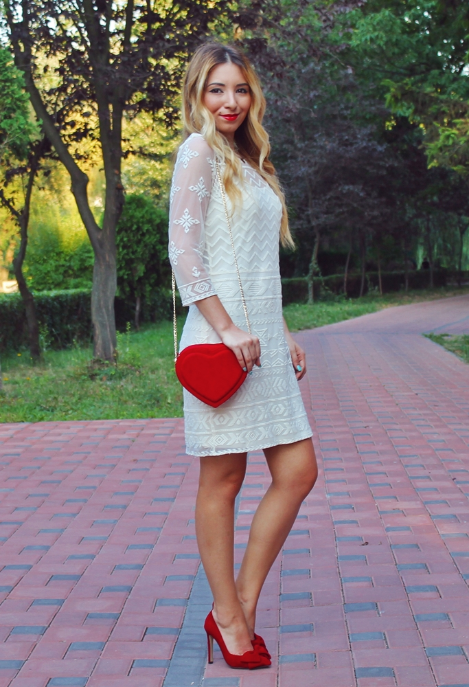 Street style - romanic white lace dress, red shoes, ribbon, red heart shape bag, summer outfit - fashion blogger Andreea Ristea