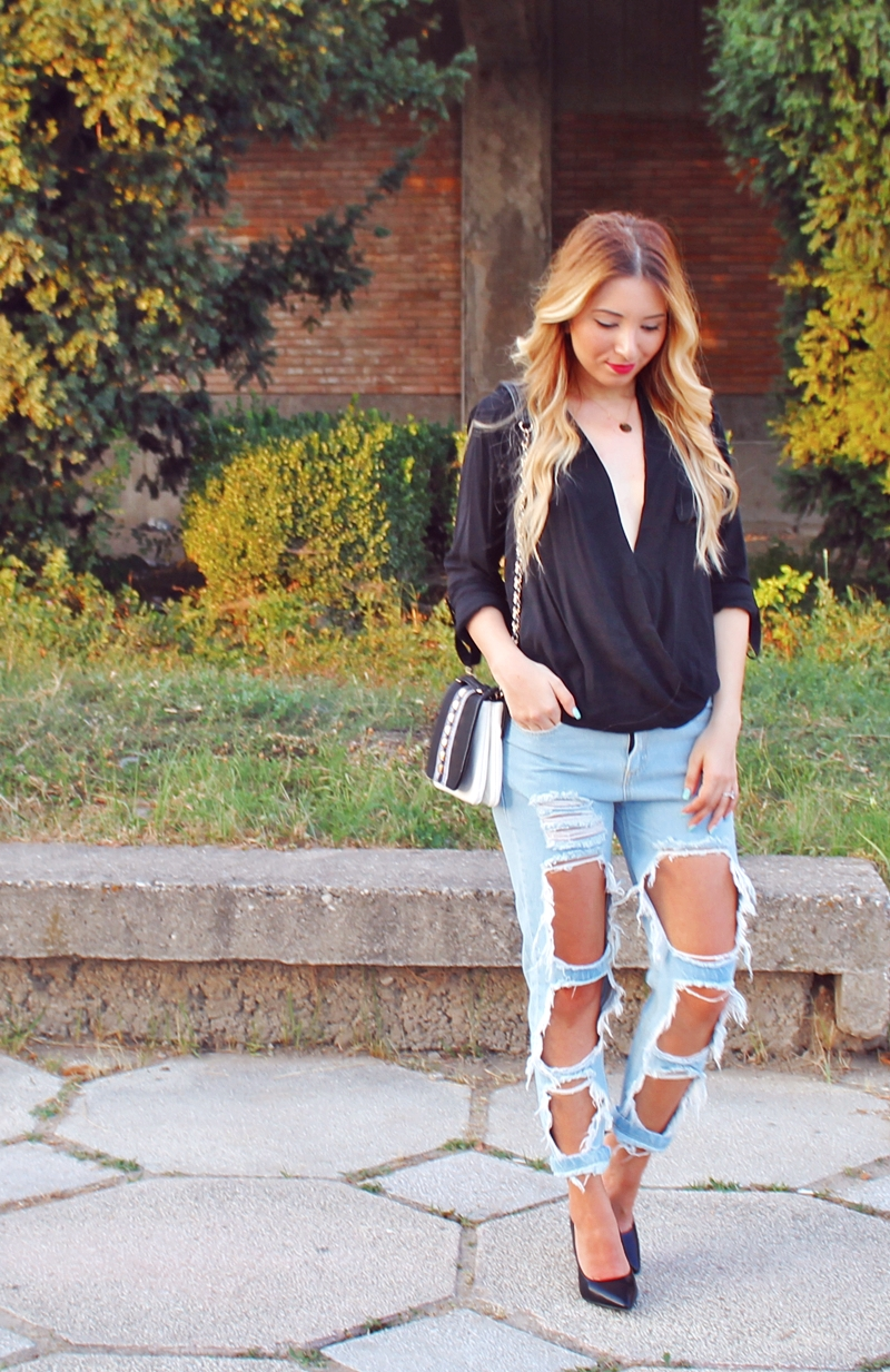 Street style - ripped jeans, black heels, black shoes, black shirt, asymmetrical blouse - summer outfit