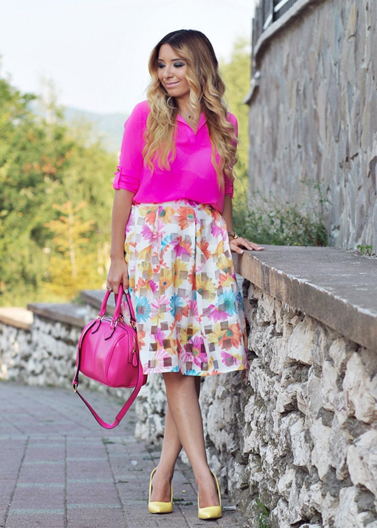 Street style: neon pink shirt, floral print skirt, pink bag, yellow high heels, andreea ristea