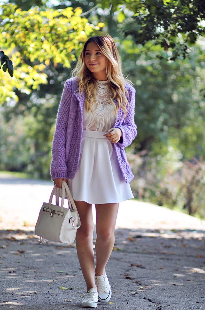 Street style - lavender/purple cardigan, all white outfit: white lace blouse, white pleated skirt, white bag