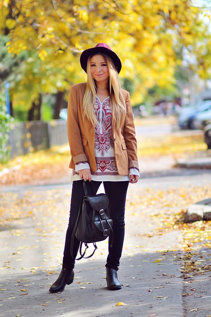 Street style brown blazer, vintage print blouse, purple hat, black jeans, black boots,