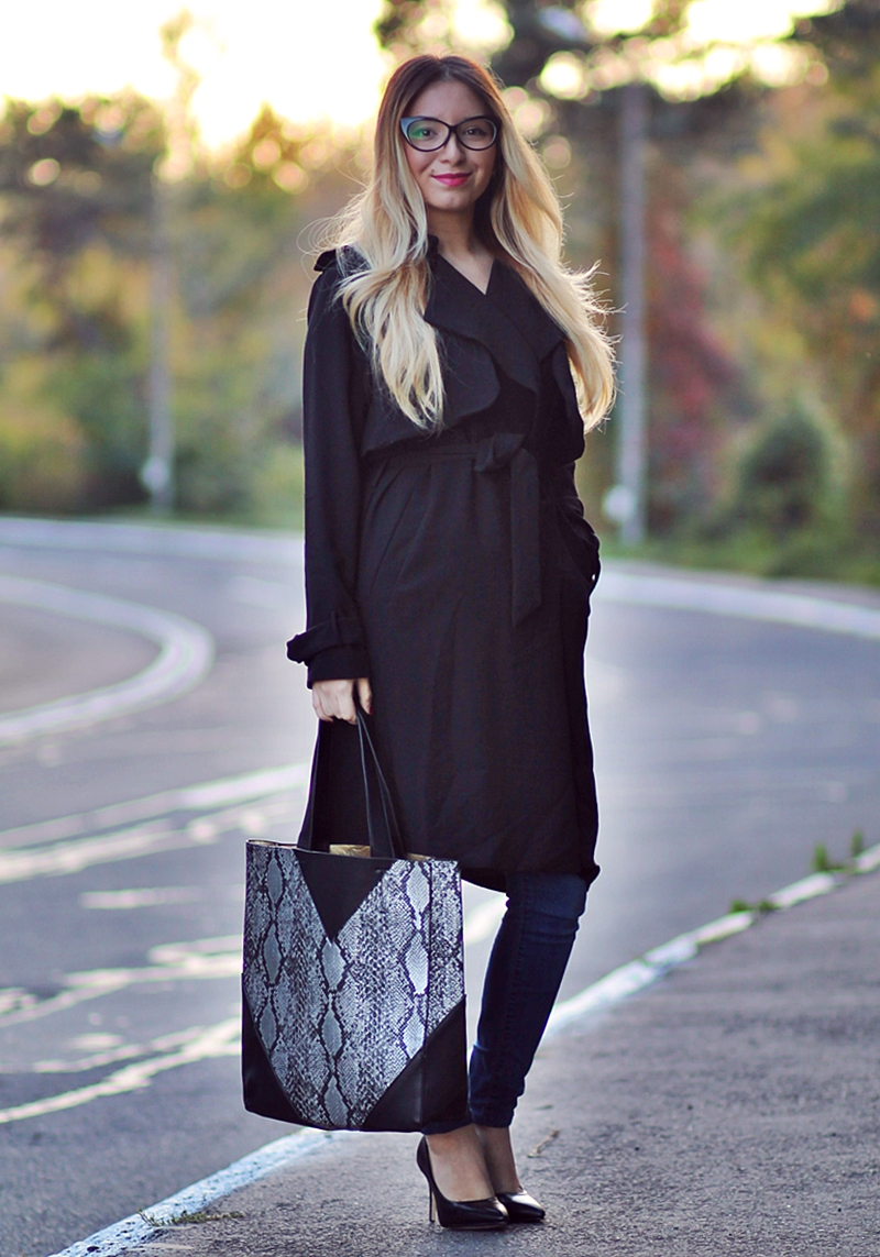 Street style black coat, blue jeans, snake print bag, black shoes, heels, eye cat eyeglasses