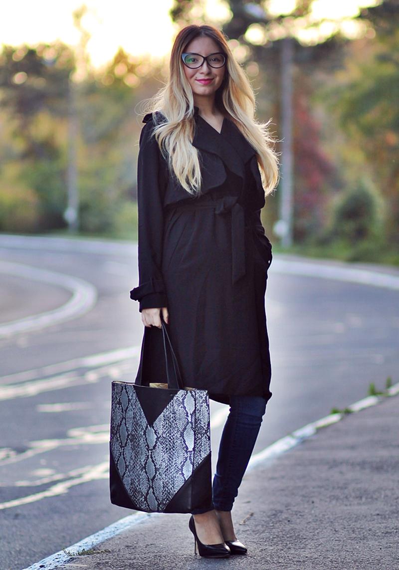 Street style black coat, blue jeans, snake print bag, black shoes, heels, eye cat eyeglasses