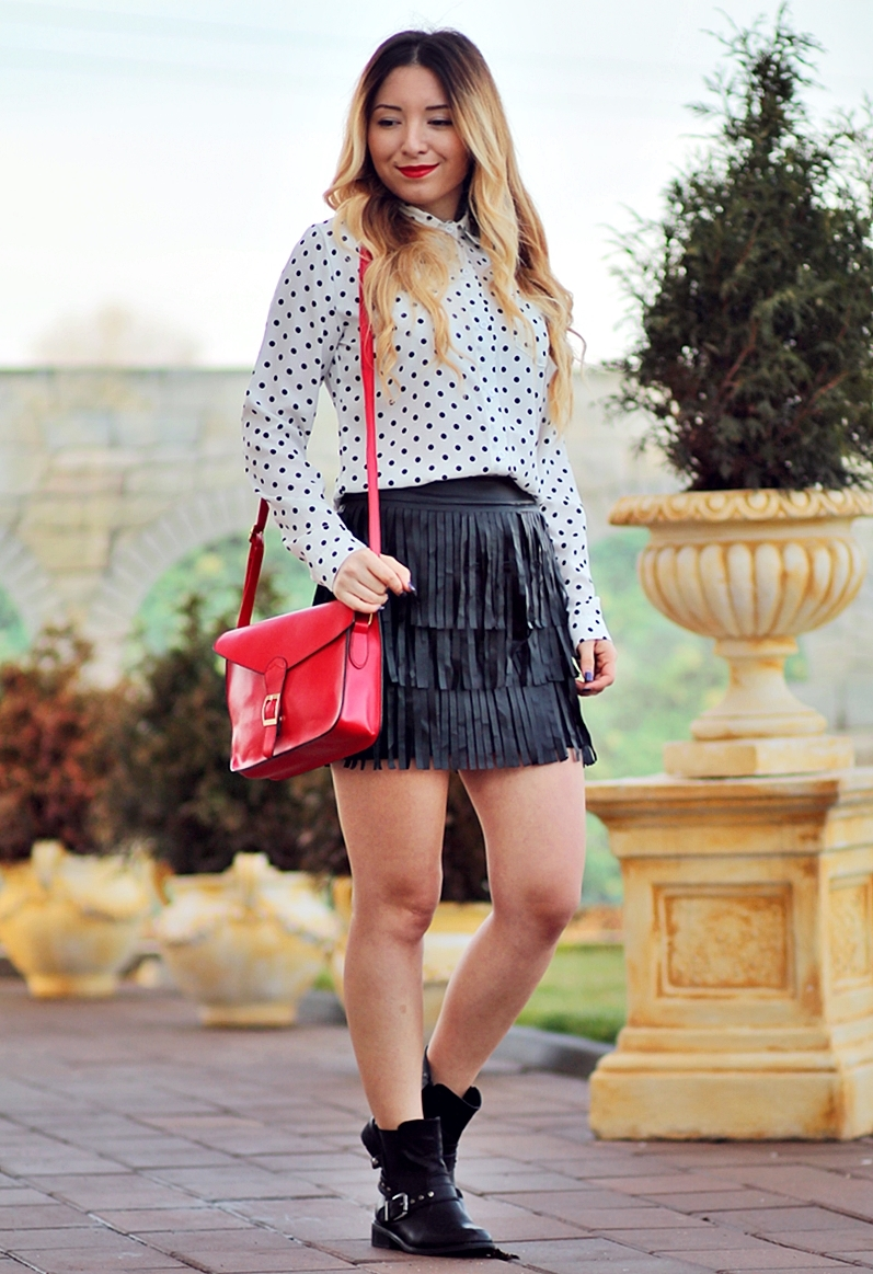 Street style - fringe black skirt, polka dots white shirt, red bag, black boots