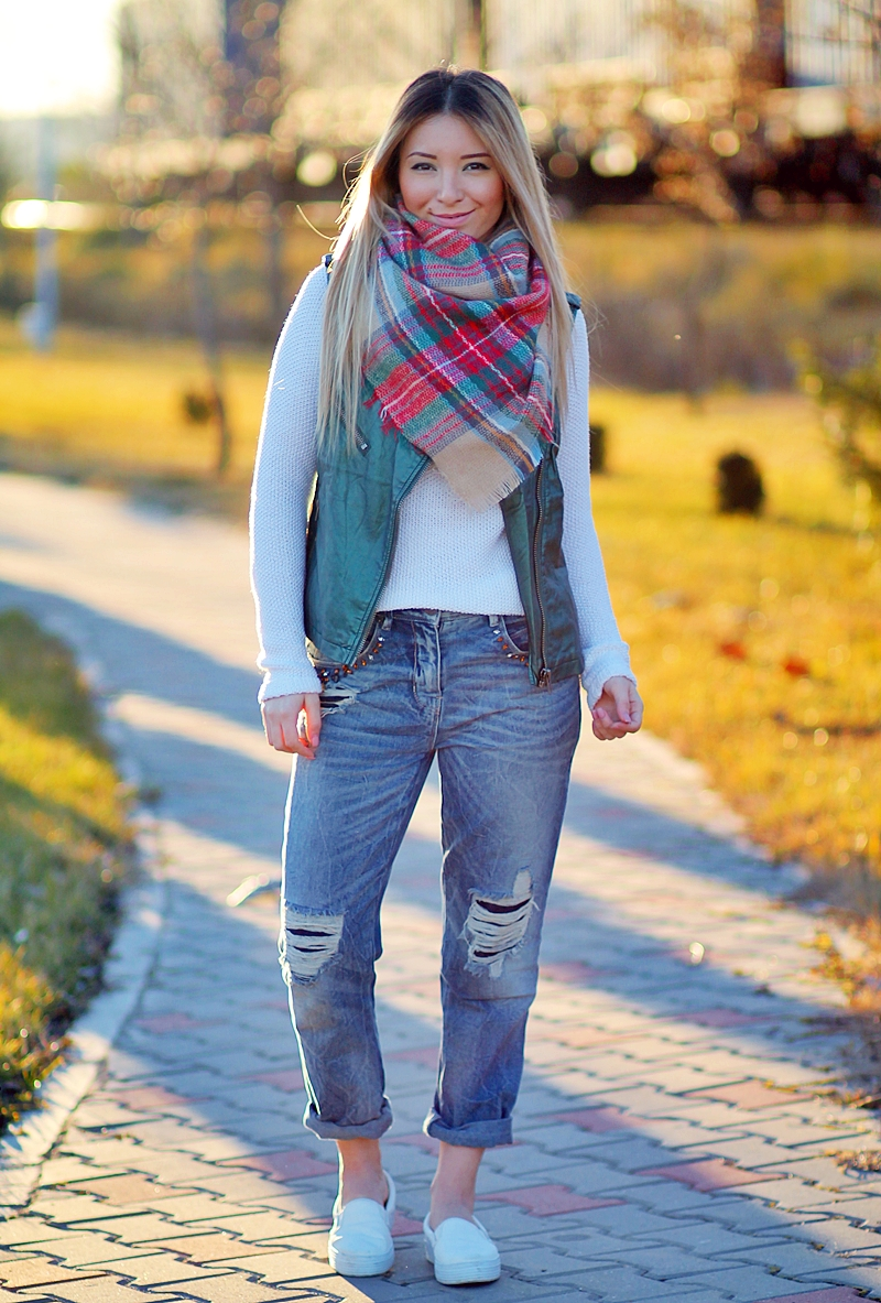 Street style: tartan, plaid scarf, white sweater, metallic green vest, boyfriend ripped jeans, white sneakers