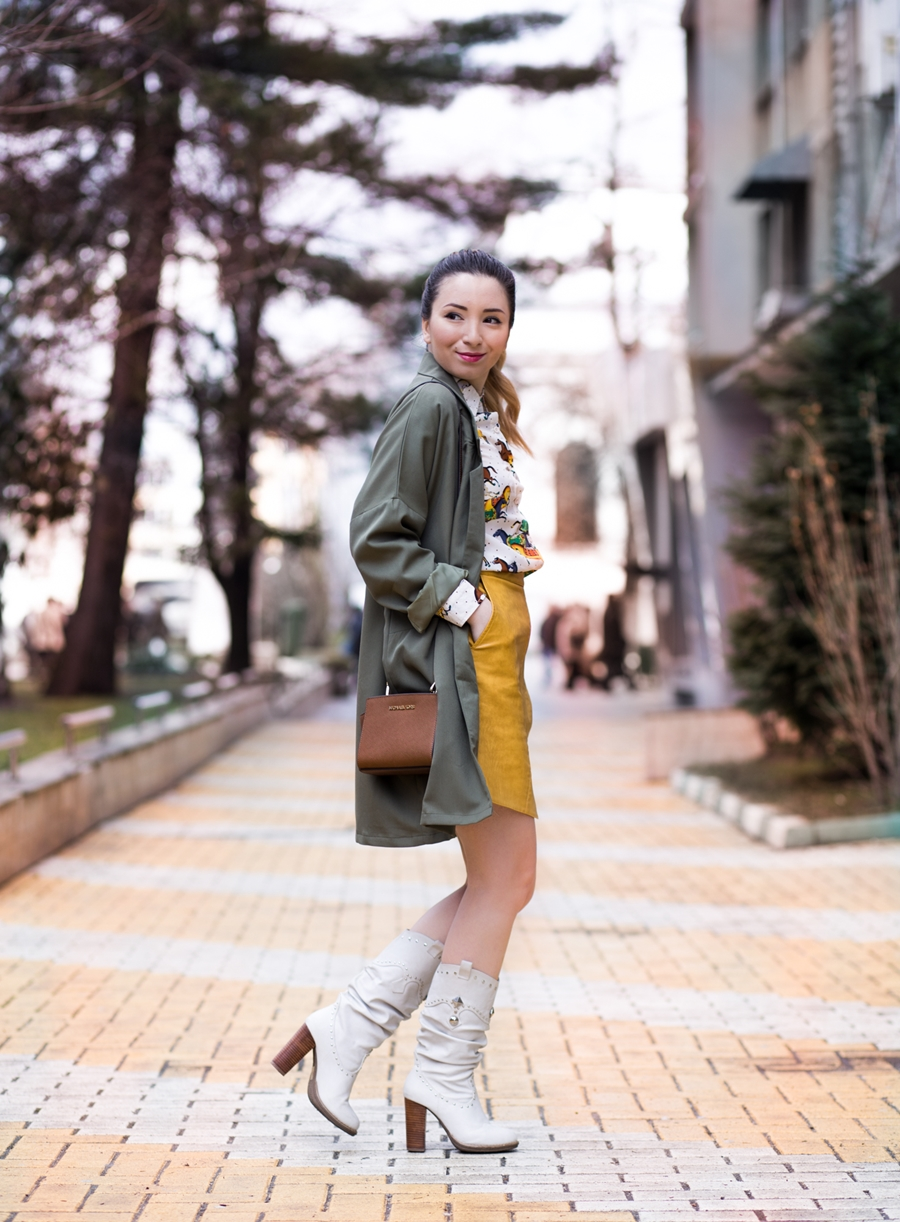 Street style: military green coat: yellow a line skirt, horses sheinside shirt, white boots, mini selma michael kors bag, andreea ristea blog
