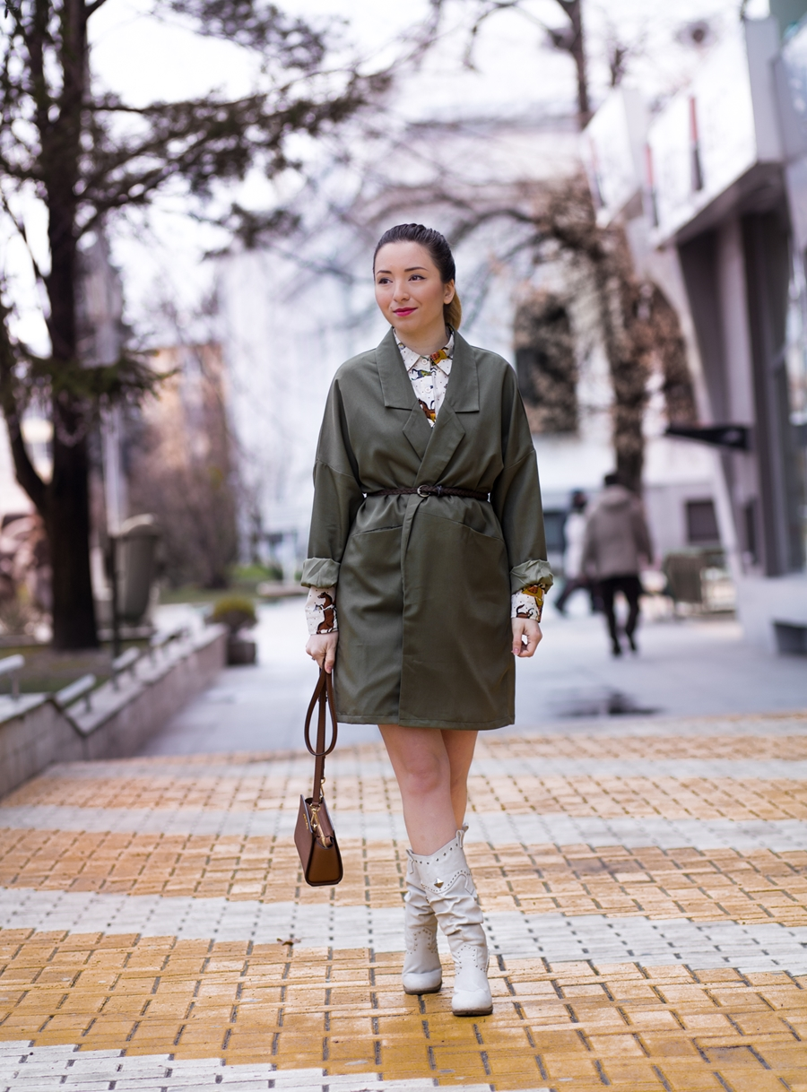 Street style: military green trench coat, wearing as a dress, white boots, ponytail, mini selma Michael Kors Bag, fashion blogger andreea ristea