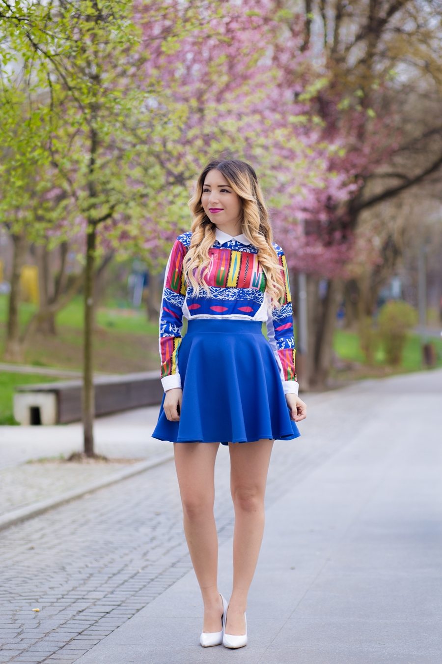 Street style, colorful geometric print shirt, blue circle skirt, like a dress, white shoes, spring outfit look, fashion blogger Andreea Ristea