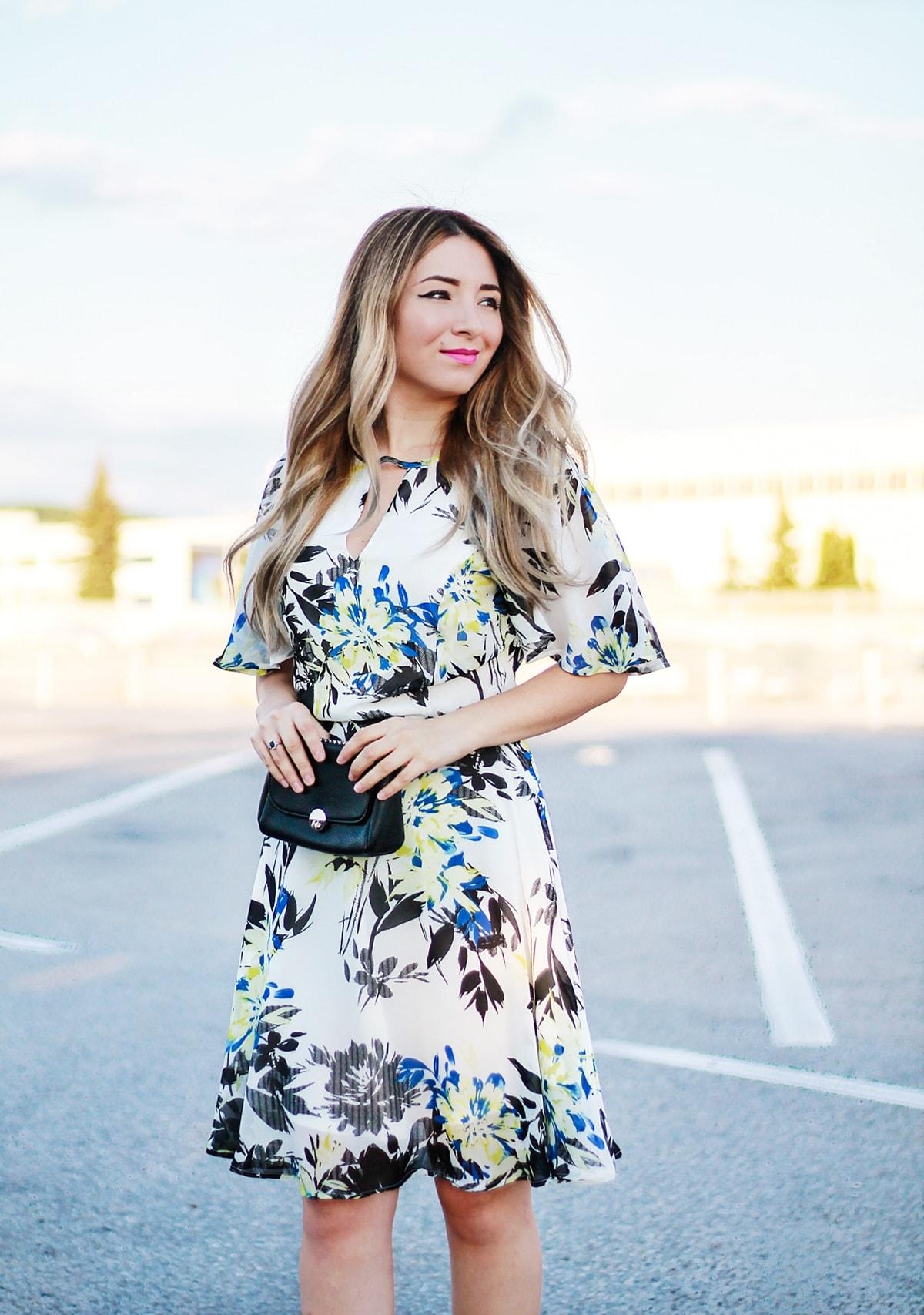 Street style: floral print dress, white, black, blue and yellow, summer look, elegant, blogger, black bag, andreea ristea, fashion blogger