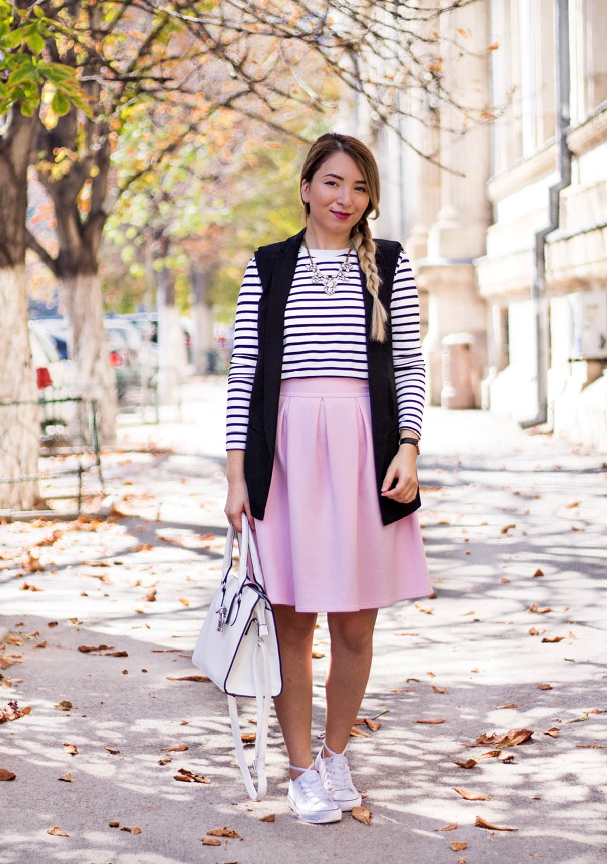Bucharest street style, powdery pink pleated skirt, stripes basic black and white blouse, skirt with sneakers, white bag, autumn look, andreea ristea