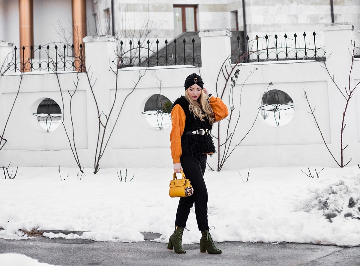 street style, winter outfit, orange sweater, black fur vest, black office pants, military green boots, lace up, yellow bag, guess, black turban, andreea ristea blogger